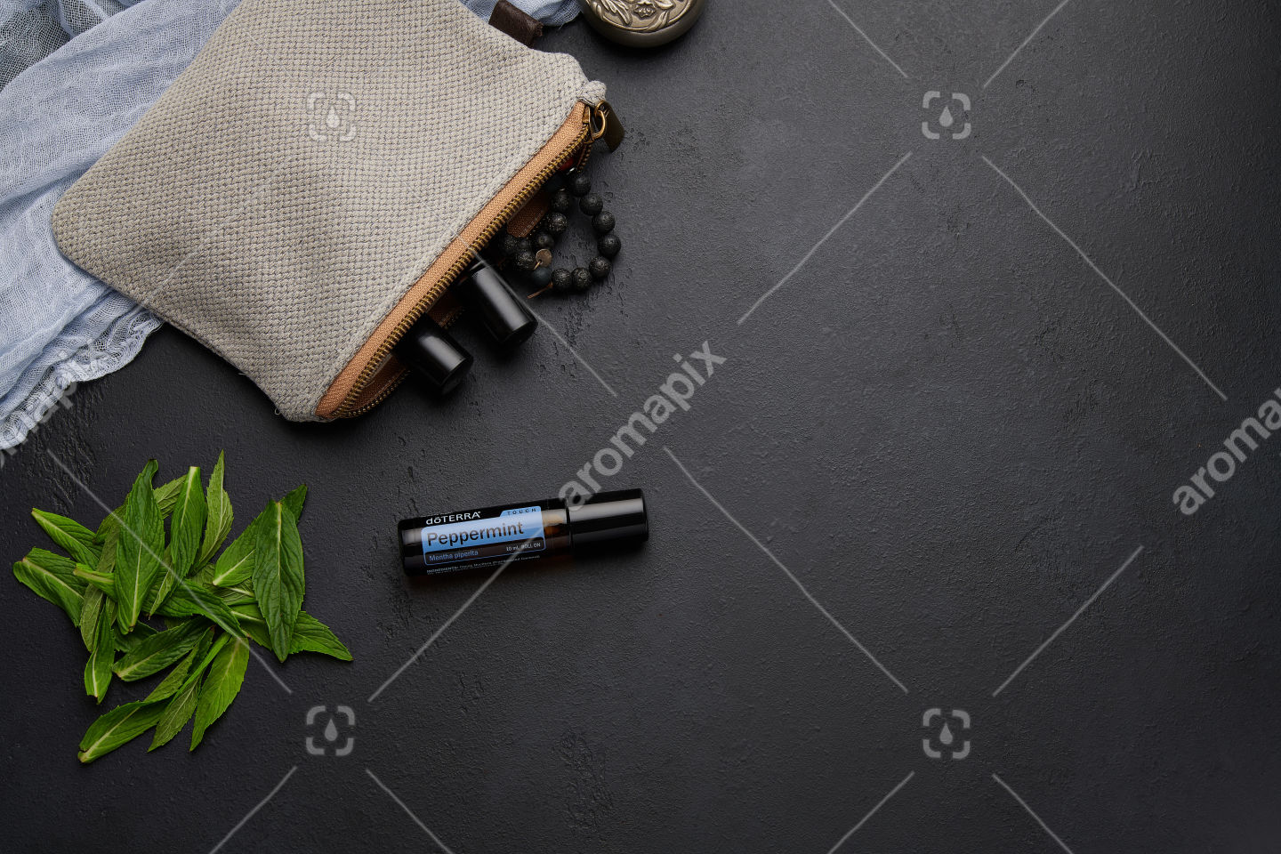 doTERRA Peppermint Touch with mint leaves on black