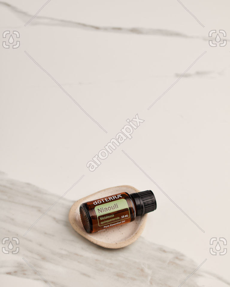 doTERRA Niaouli in a small ceramic dish on white marble