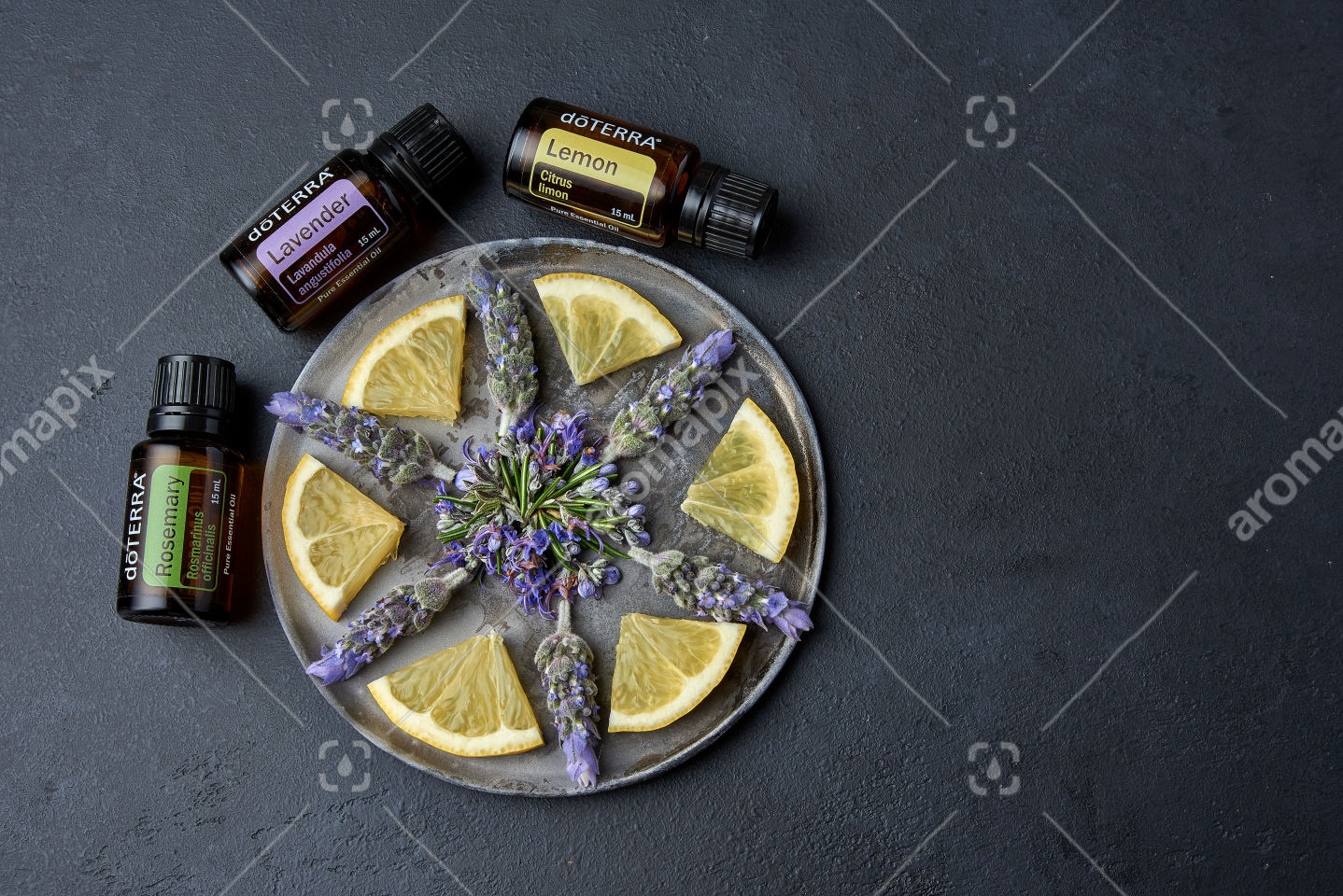 doTERRA Rosemary, Lavender and Lemon with flowers on black