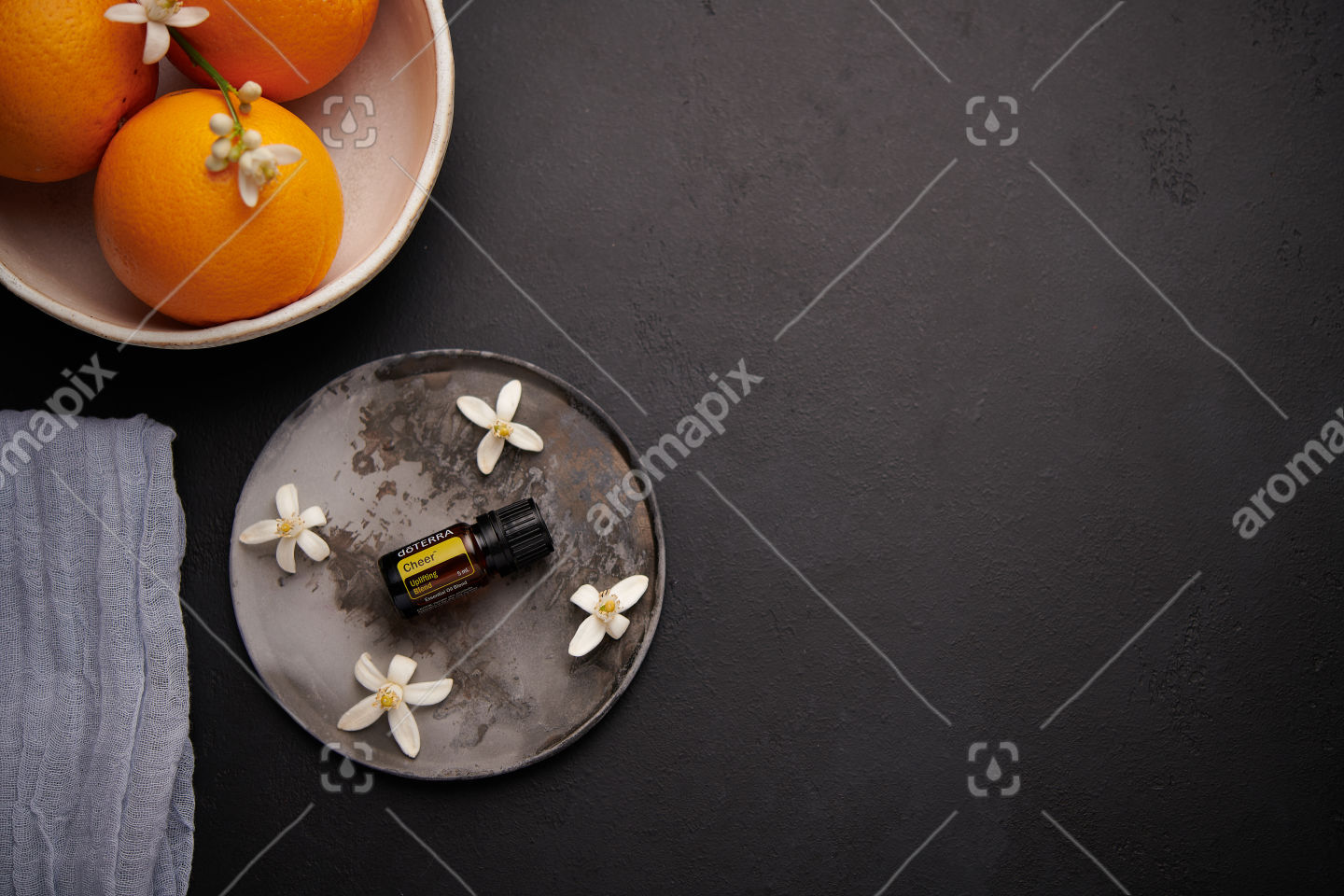 doTERRA Cheer with orange blossoms on black