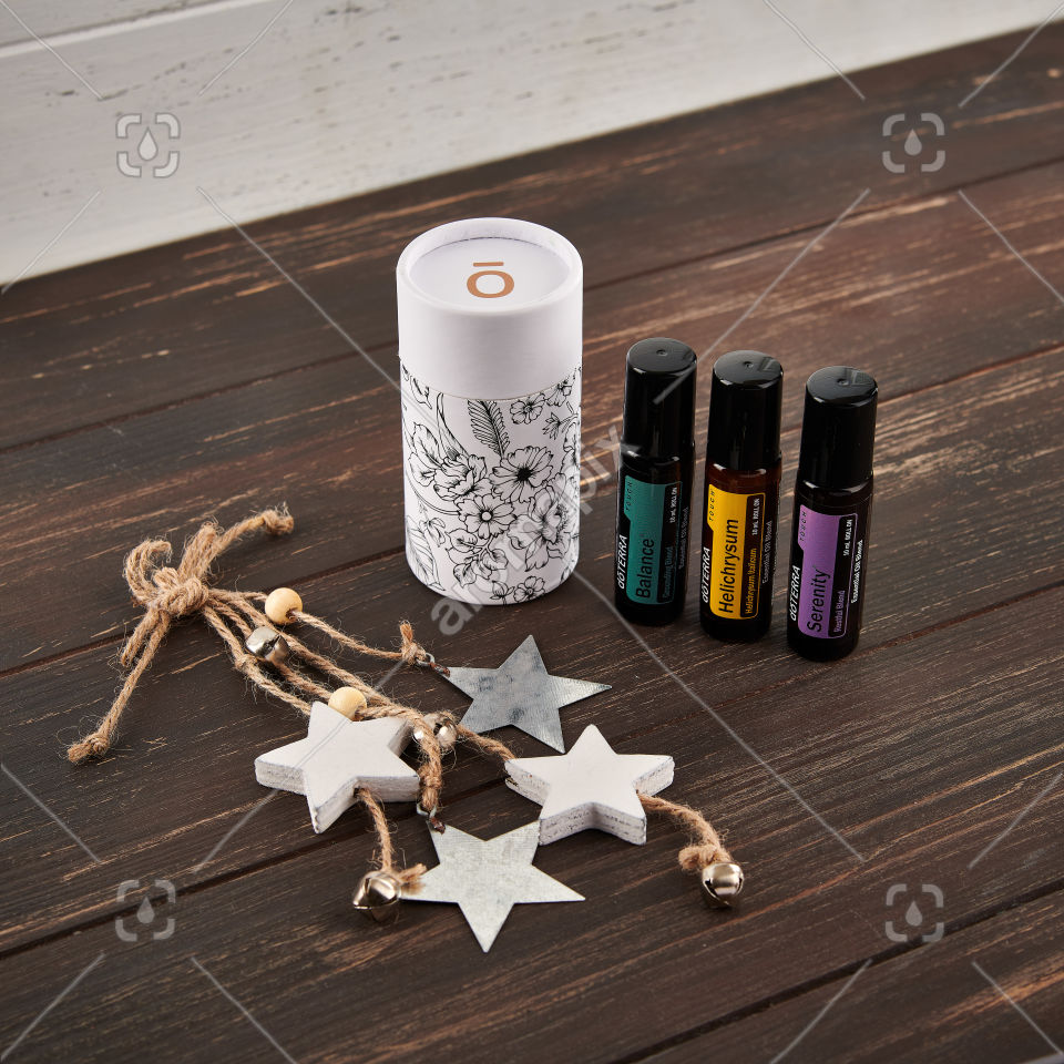 doTERRA Balance Touch, Helichrysum Touch, and Serenity Touch with a beautiful cylinder gift box on brown