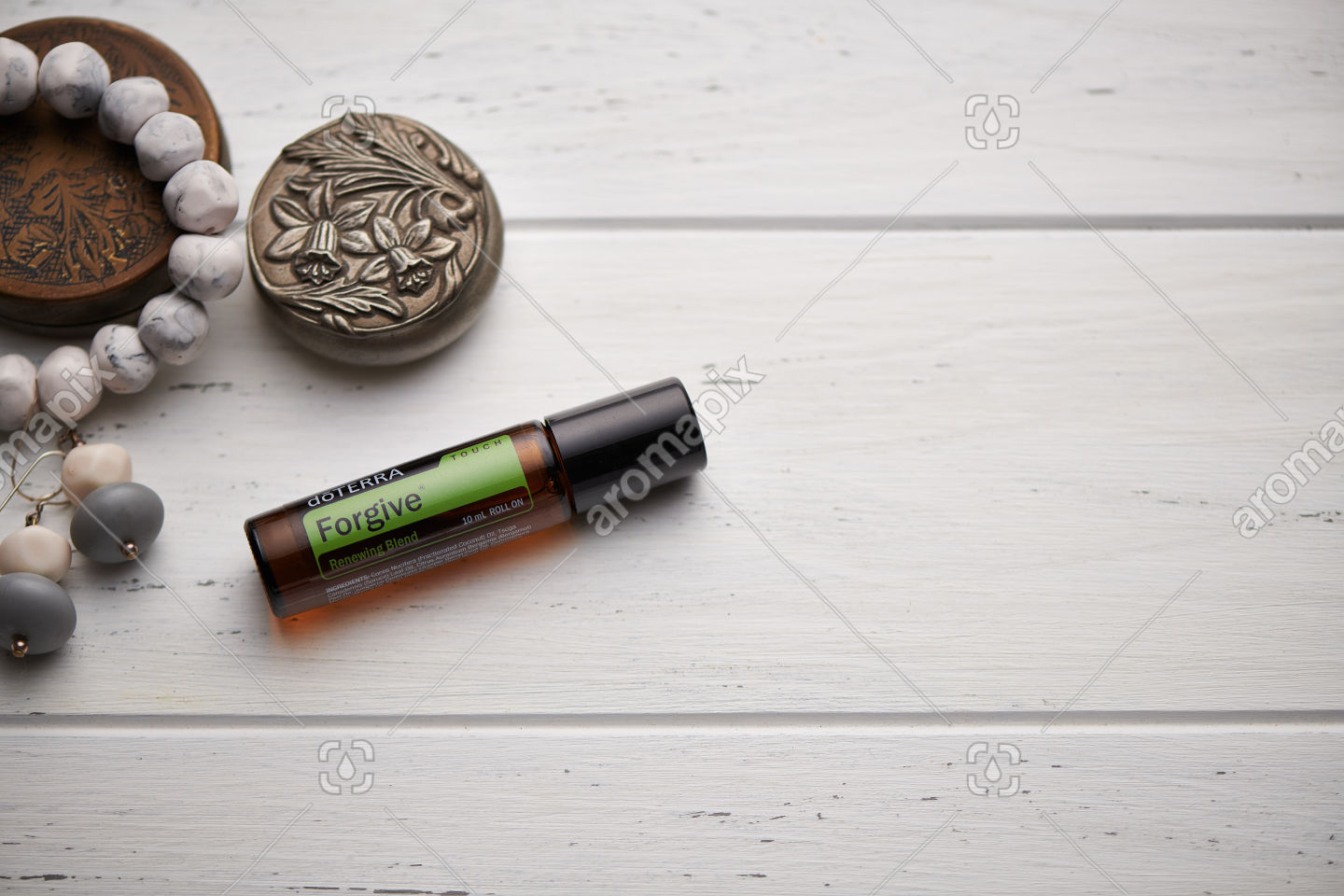 doTERRA Forgive Touch on rustic background