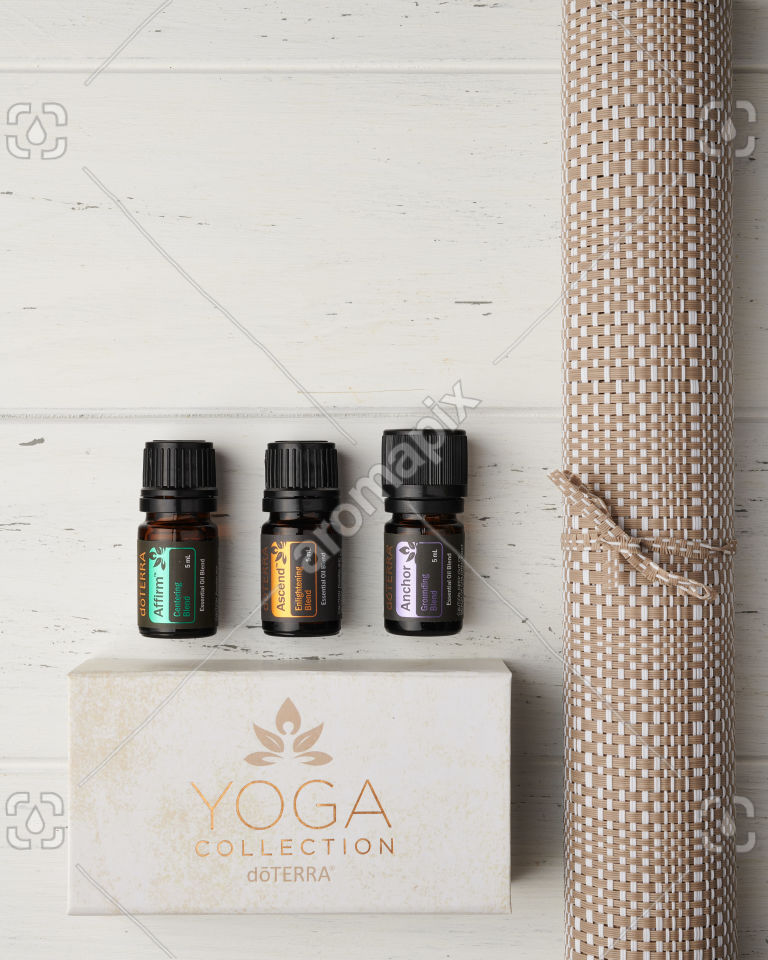 doTERRA Yoga Collection of Affirm, Ascend and Anchor and yoga mat on white