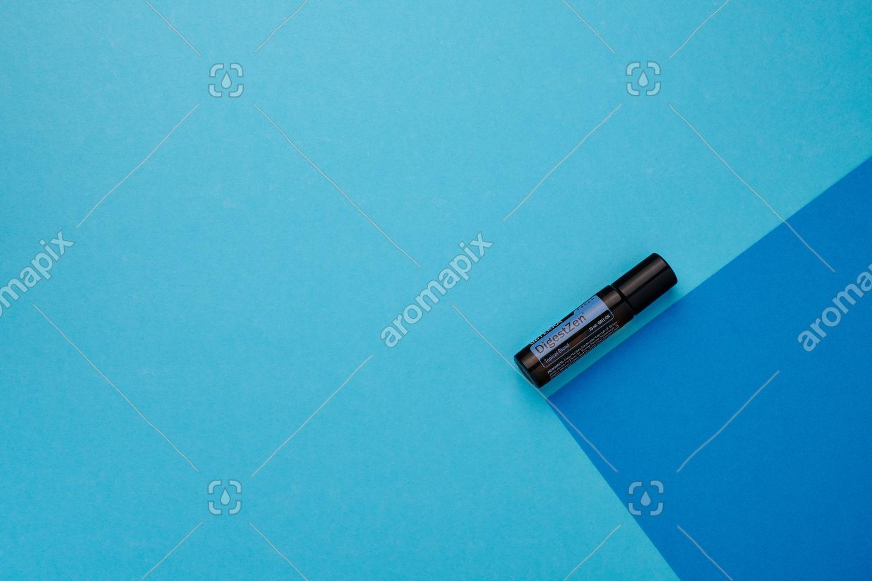doTERRA DigestZen Touch on a dark blue and light blue background