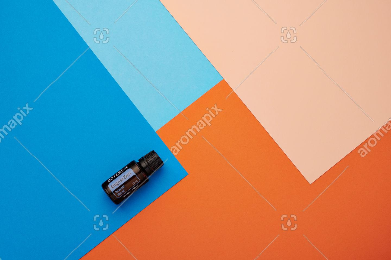 doTERRA DigestZen on a blue and orange background