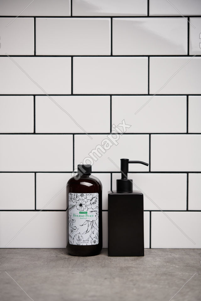 doTERRA Holiday Peace Hand Wash and soap dispenser on bathroom bench
