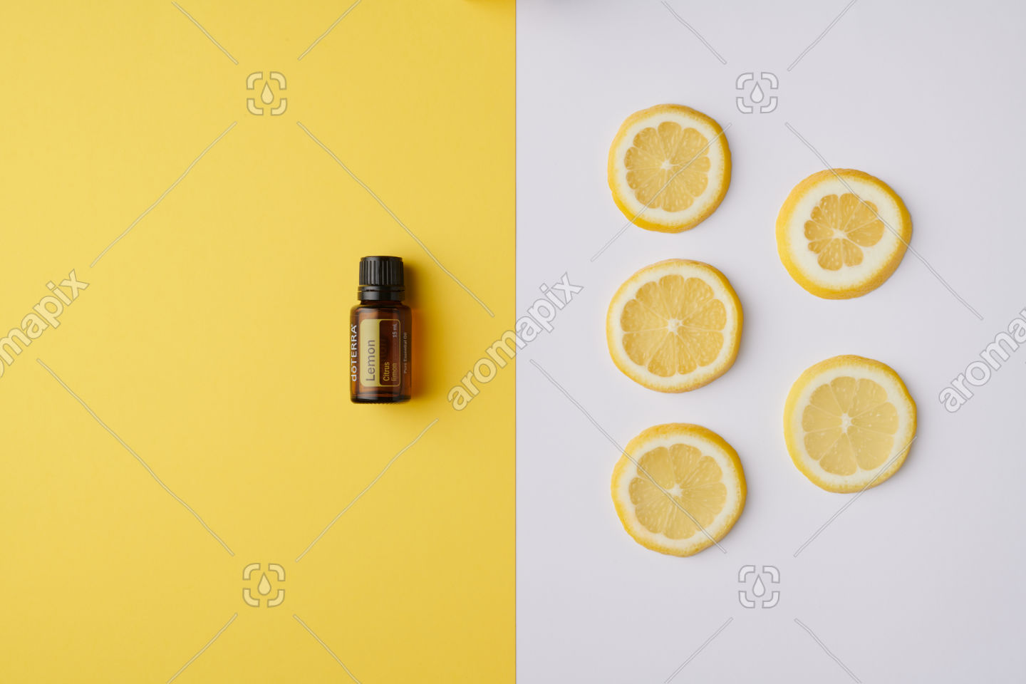 doTERRA Lemon product and slices on yellow and white background