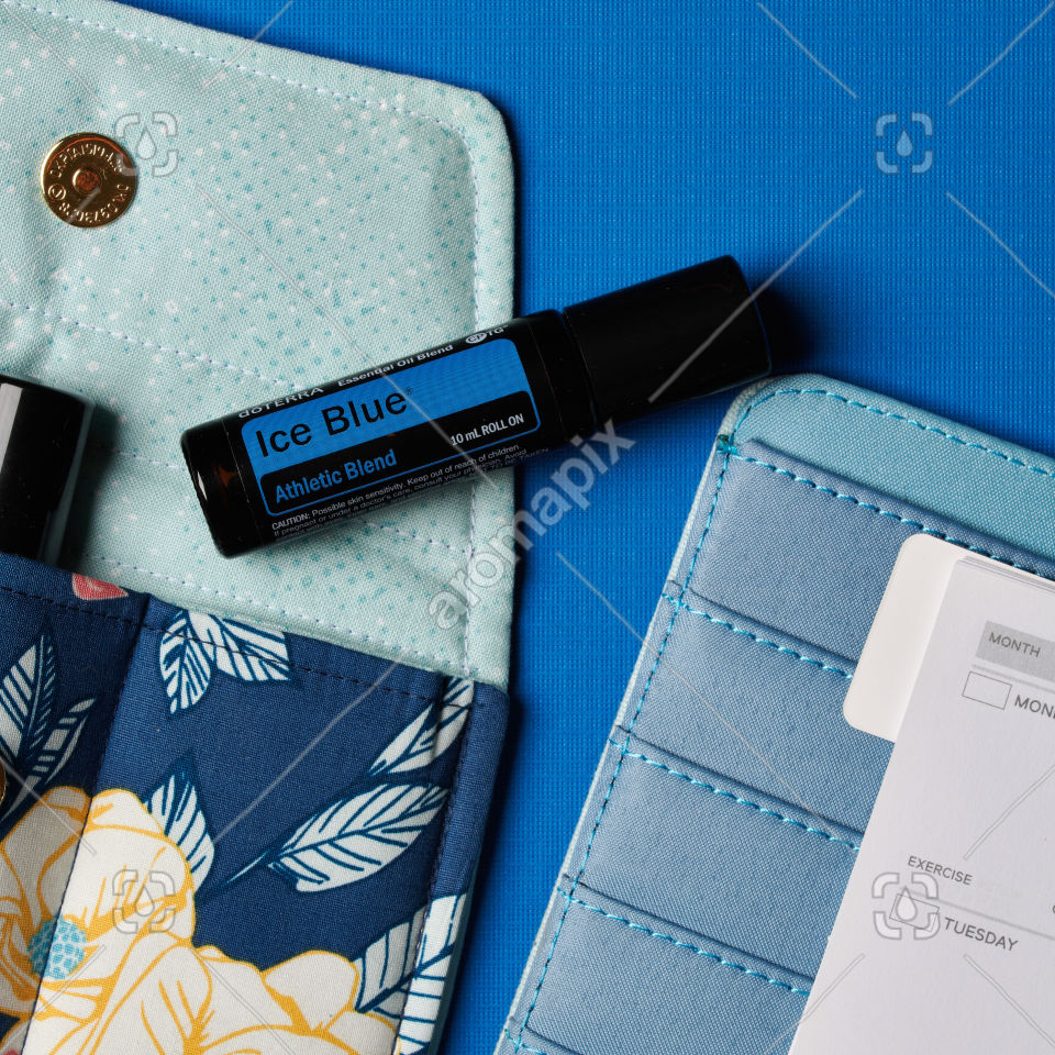 doTERRA Ice Blue Roll On with accessories on blue