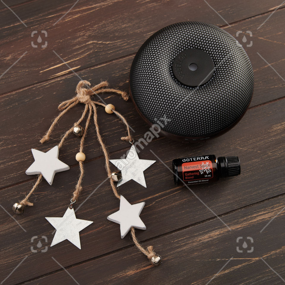 doTERRA Brevi Walnut Diffuser with Harvest Spice on wood