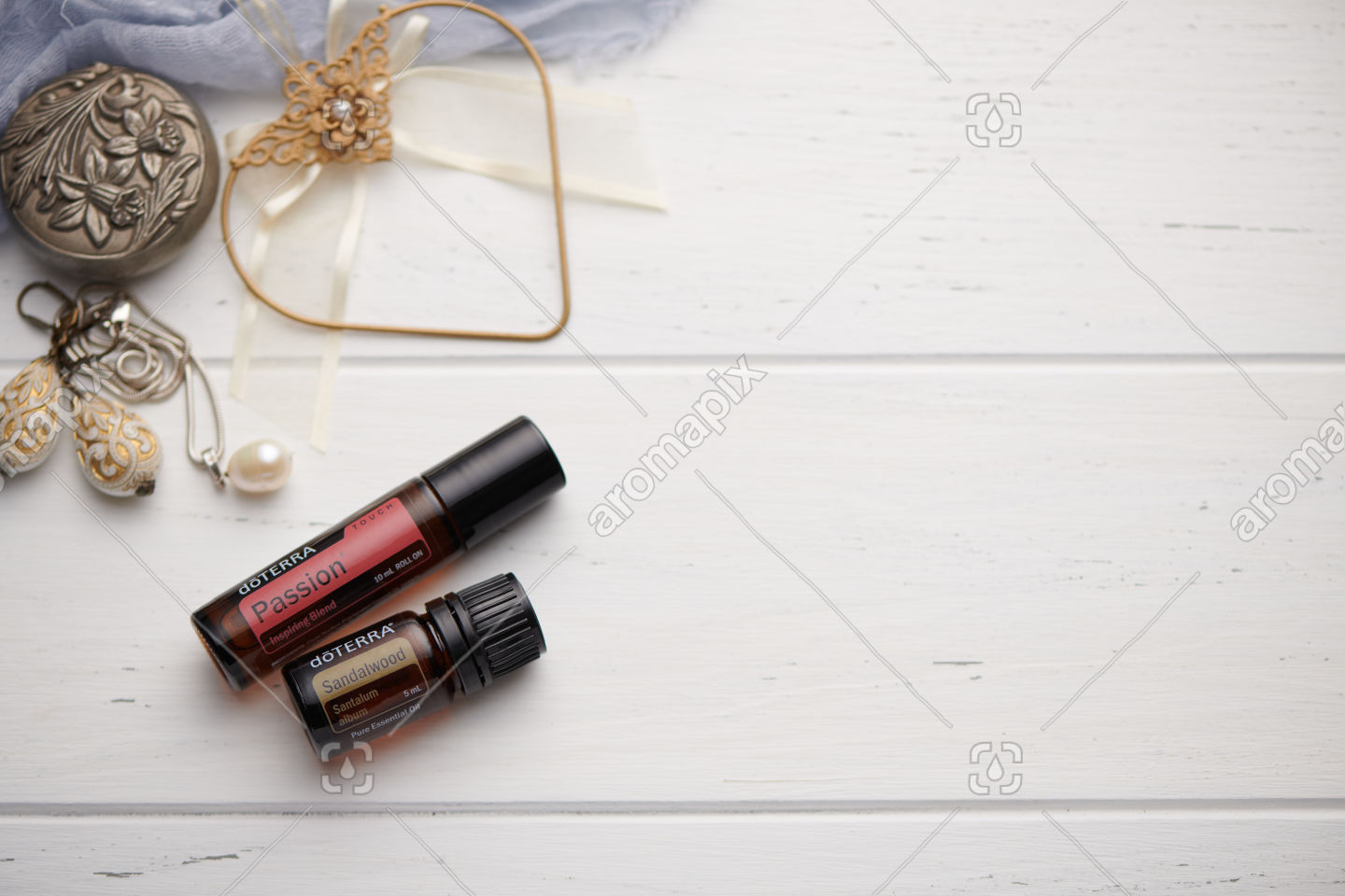 doTERRA Passion Touch and Sandalwood on white vintage wooden background