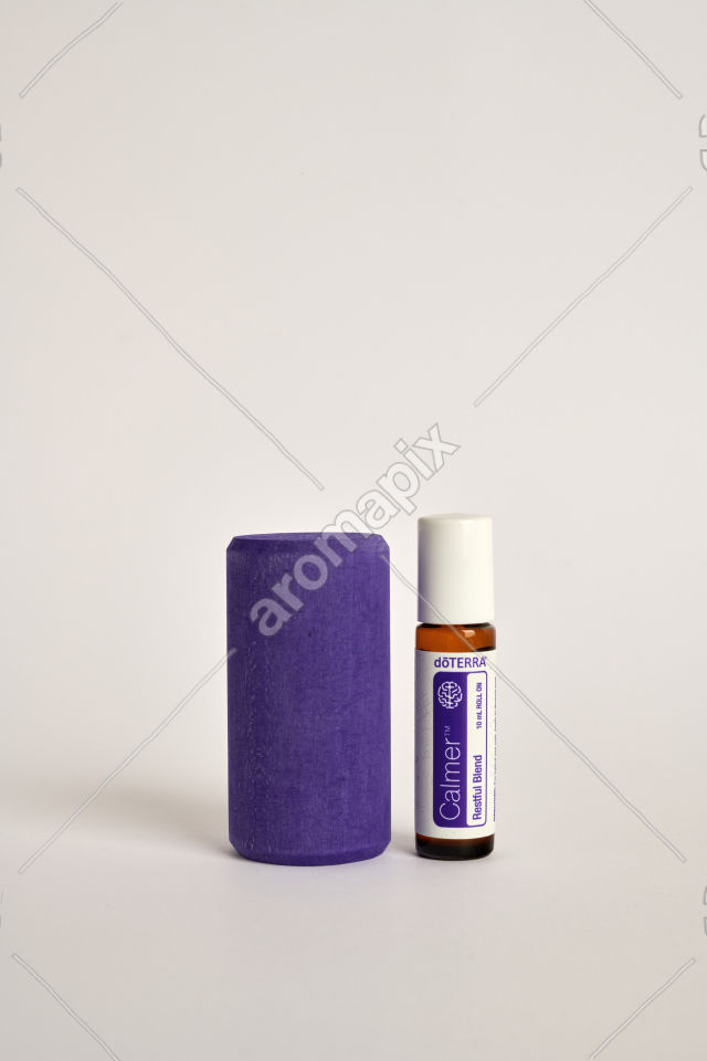 doTERRA Kids Oil Collection Calmer with a wood block