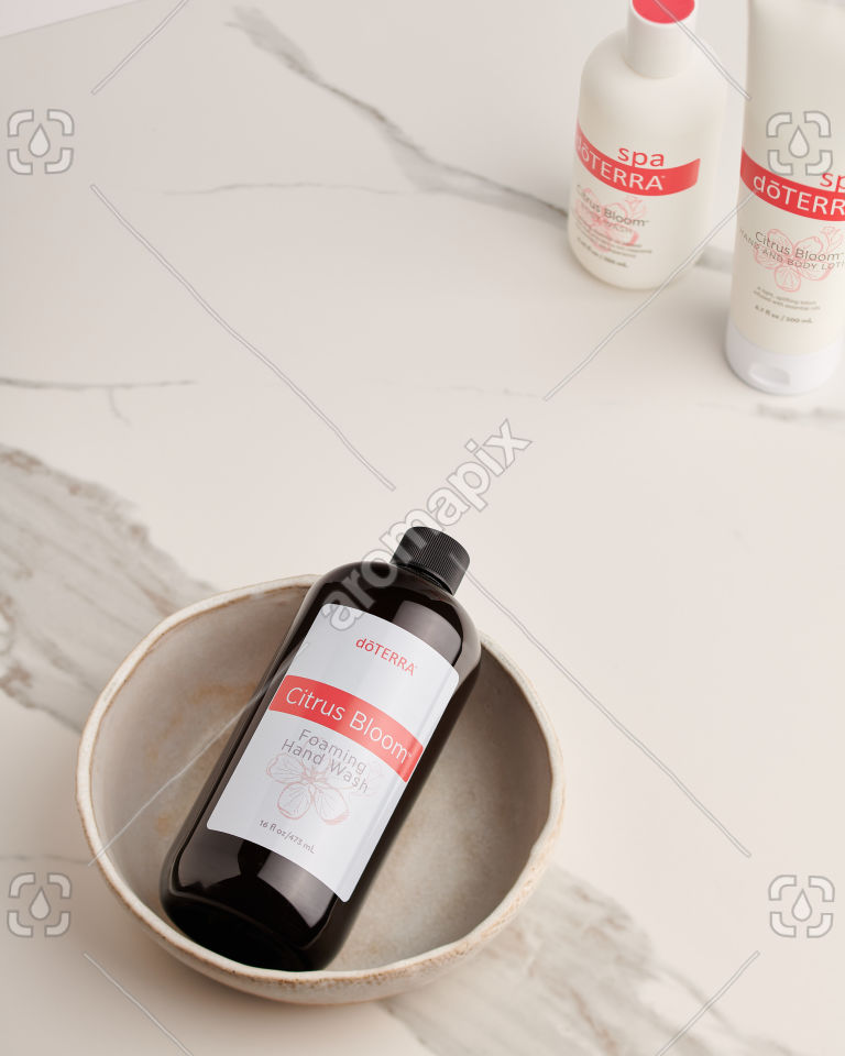 doTERRA Citrus Bloom Foaming Hand Wash in a ceramic bowl on white marble
