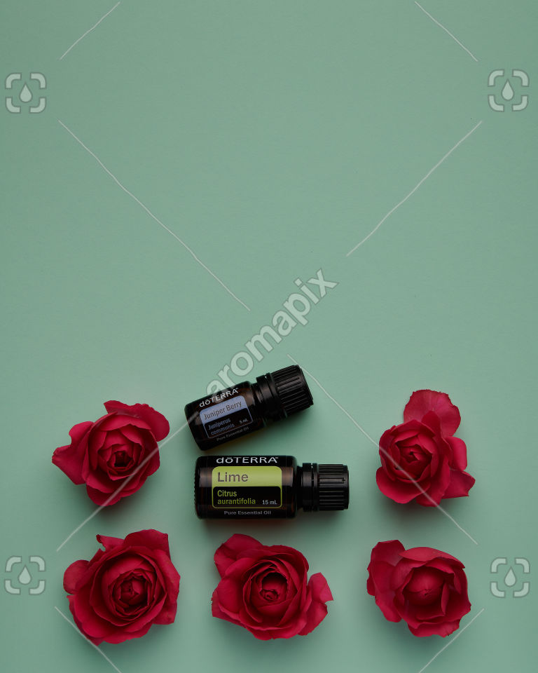 doTERRA Lime and Juniper Berry with roses on green