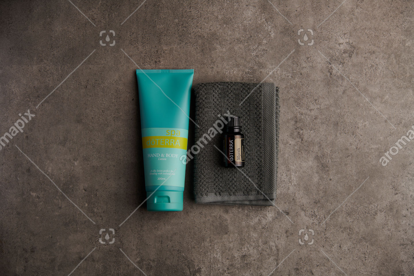 doTERRA Spa Hand and Body Lotion and Myrrh essential oil on stone