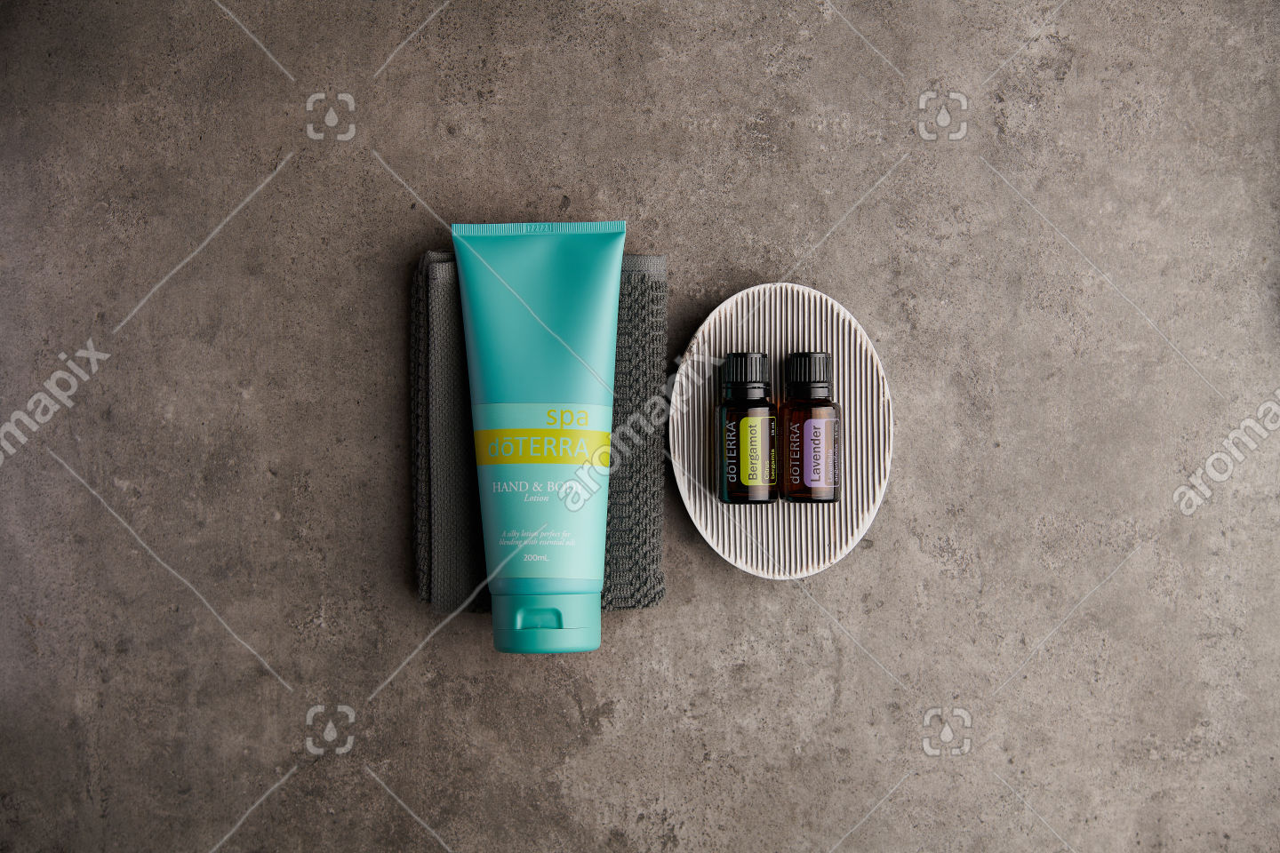 doTERRA Spa Hand and Body Lotion with Bergamot and Lavender essential oils on stone