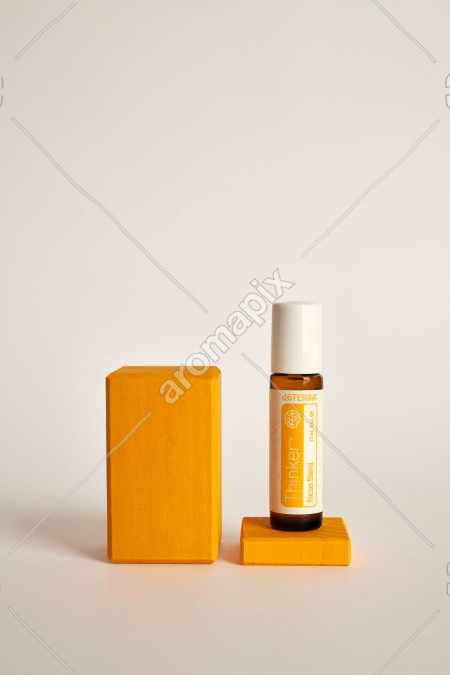 doTERRA Kids Oil Collection Thinker on a wood block