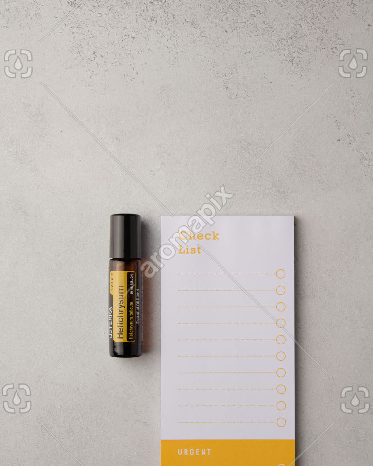 doTERRA Helichrysum Touch and notepad on white