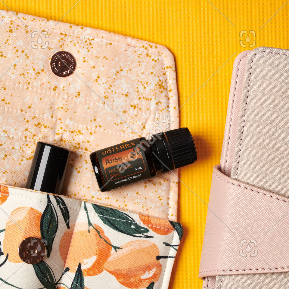 doTERRA Arise with accessories on yellow