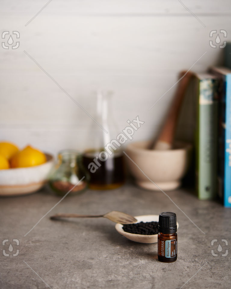 doTERRA Black Pepper with peppercorns on a kitchen bench
