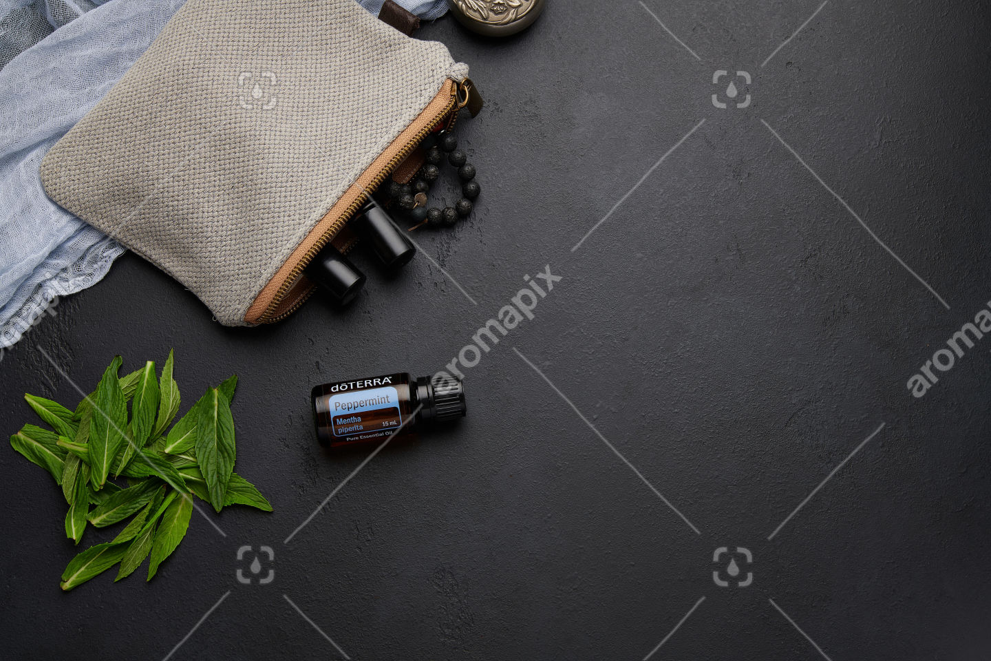 doTERRA Peppermint with mint leaves on black
