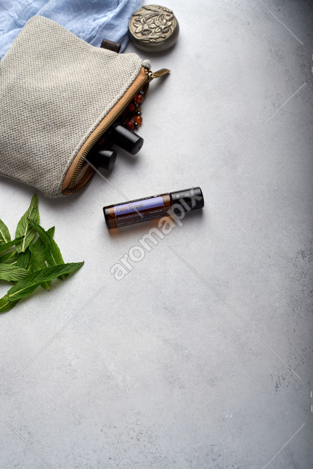 doTERRA PastTense with mint leaves on white