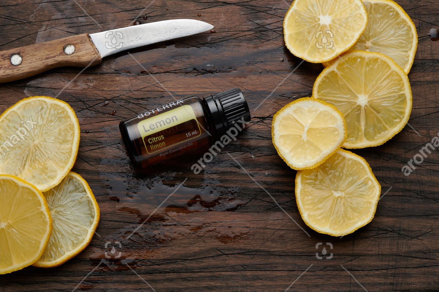 doTERRA Lemon product and slices on wooden board