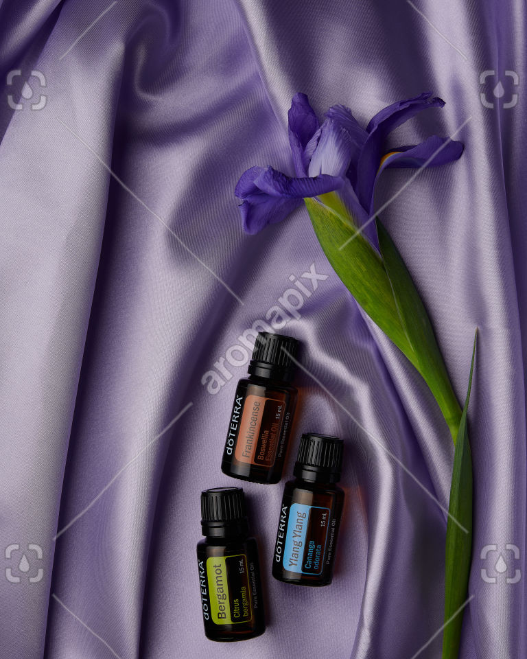 doTERRA Bergamot, Frankincense and Ylang Ylang on purple