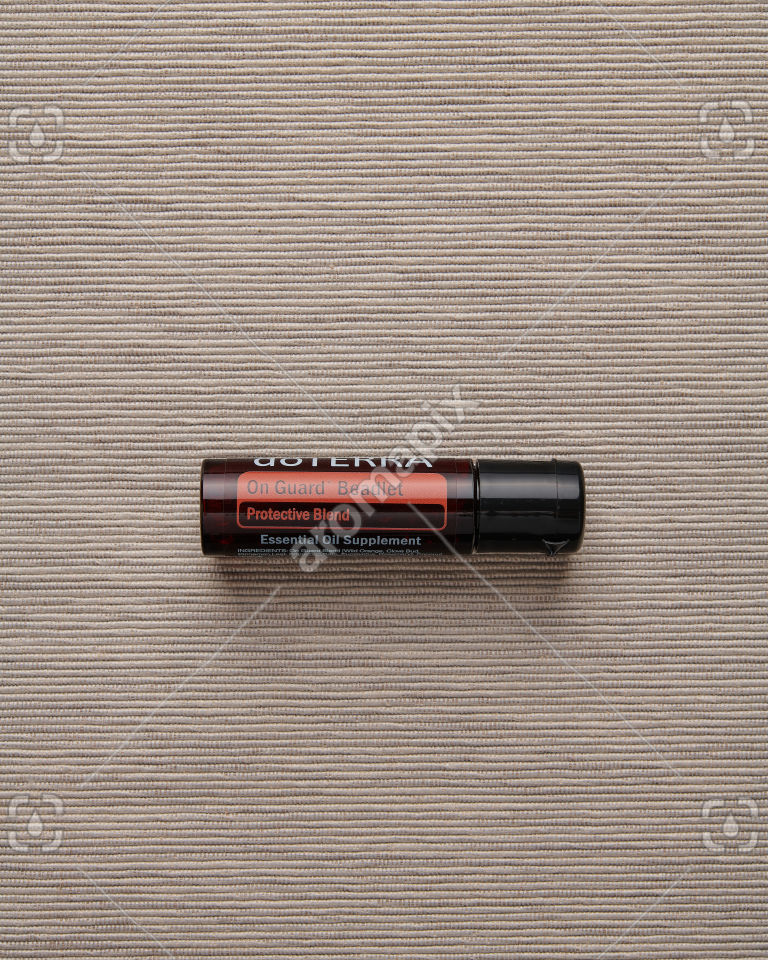 doTERRA On Guard Beadlet on pale gray