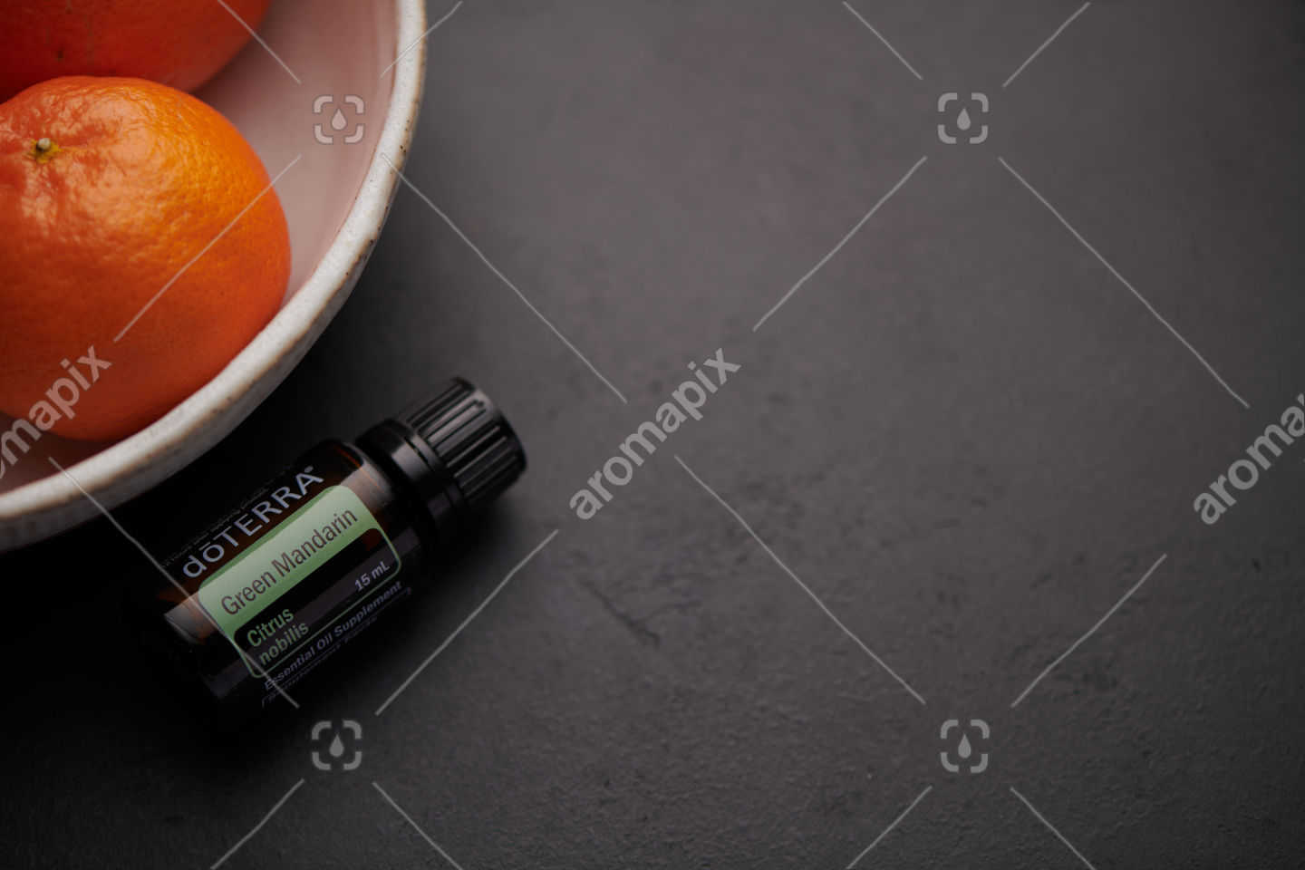 doTERRA Green Mandarin product and mandarins in white bowl