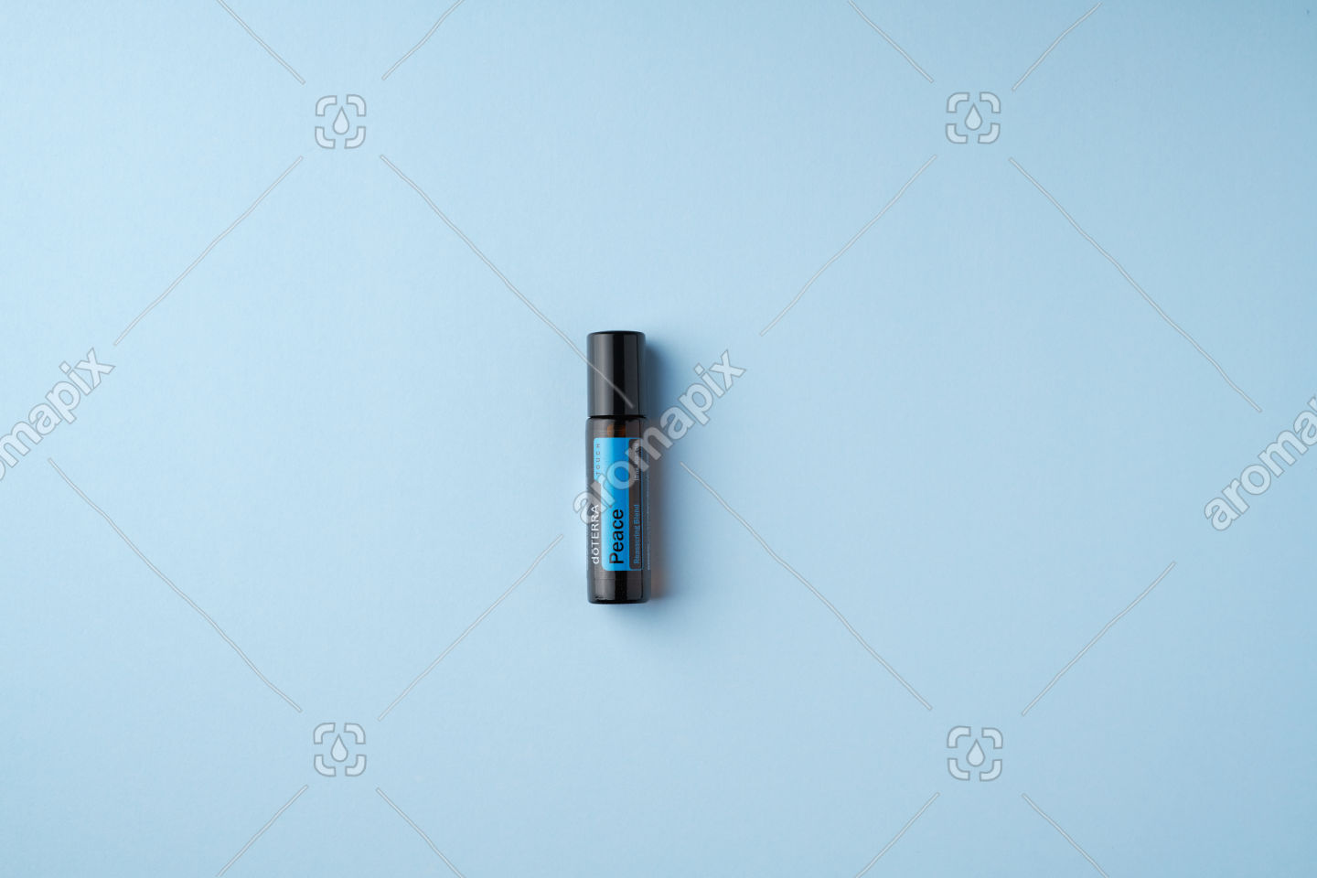 doTERRA Peace Touch on light blue