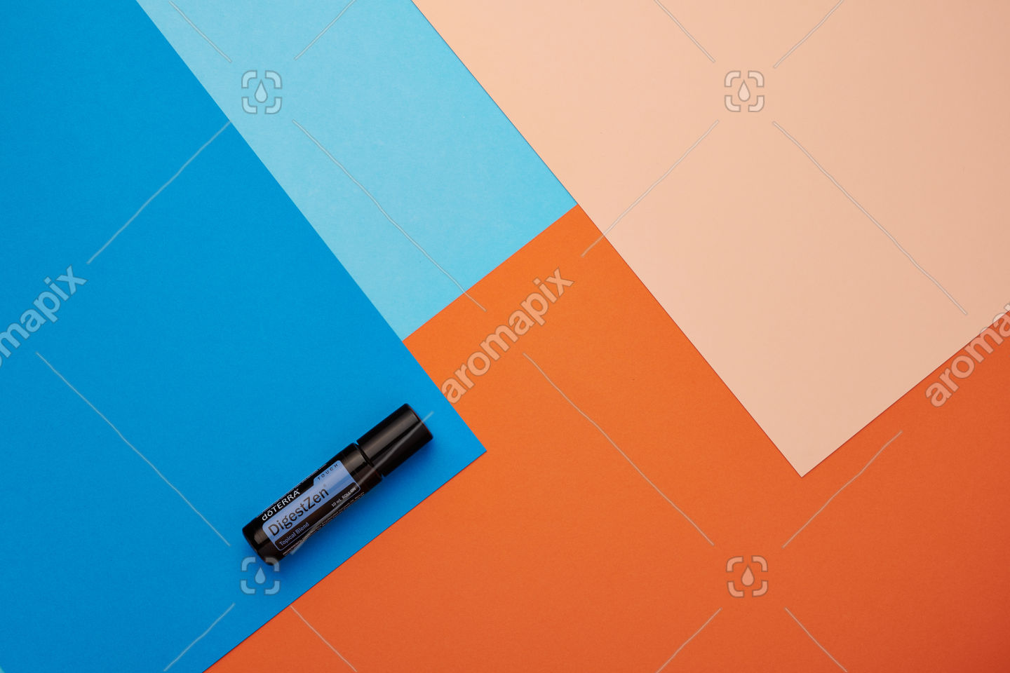 doTERRA DigestZen Touch on a blue and orange background