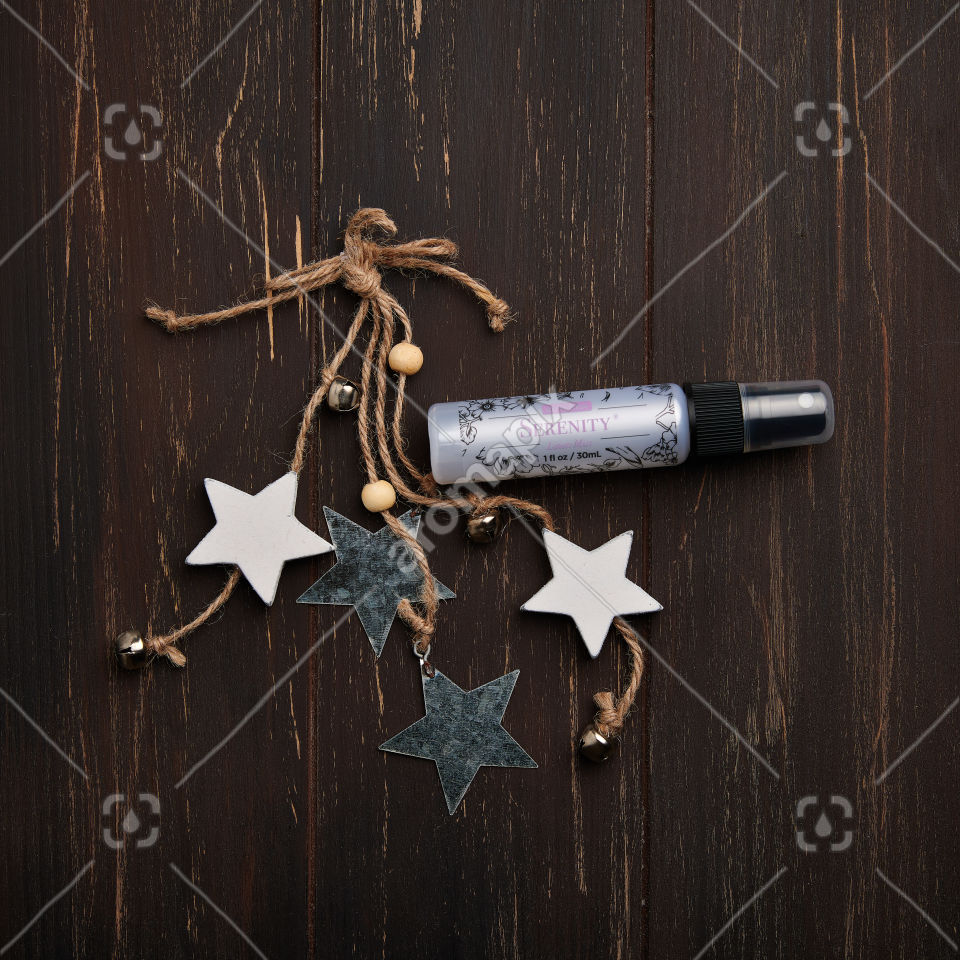 doTERRA Serenity Linen Mist with holiday decorations on brown