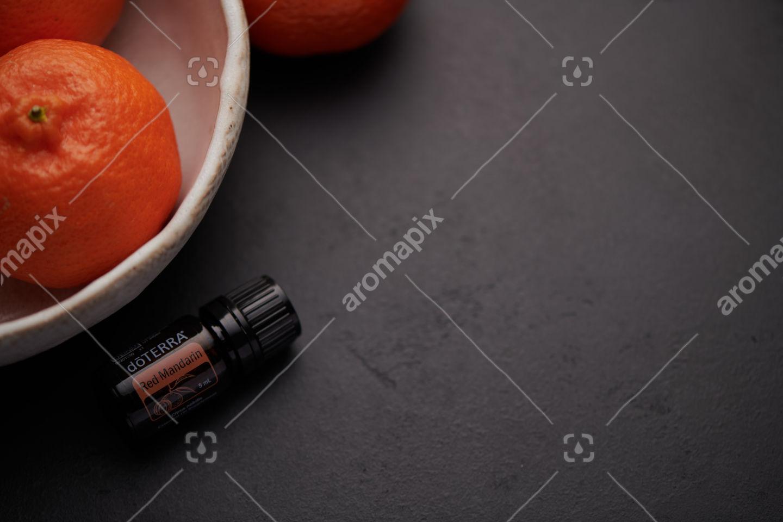 doTERRA Red Mandarin product and mandarins in white bowl