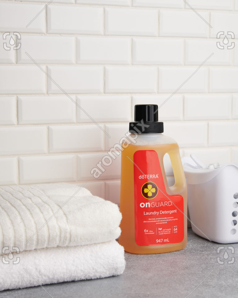 doTERRA On Guard Laundry Detergent and towels on laundry bench