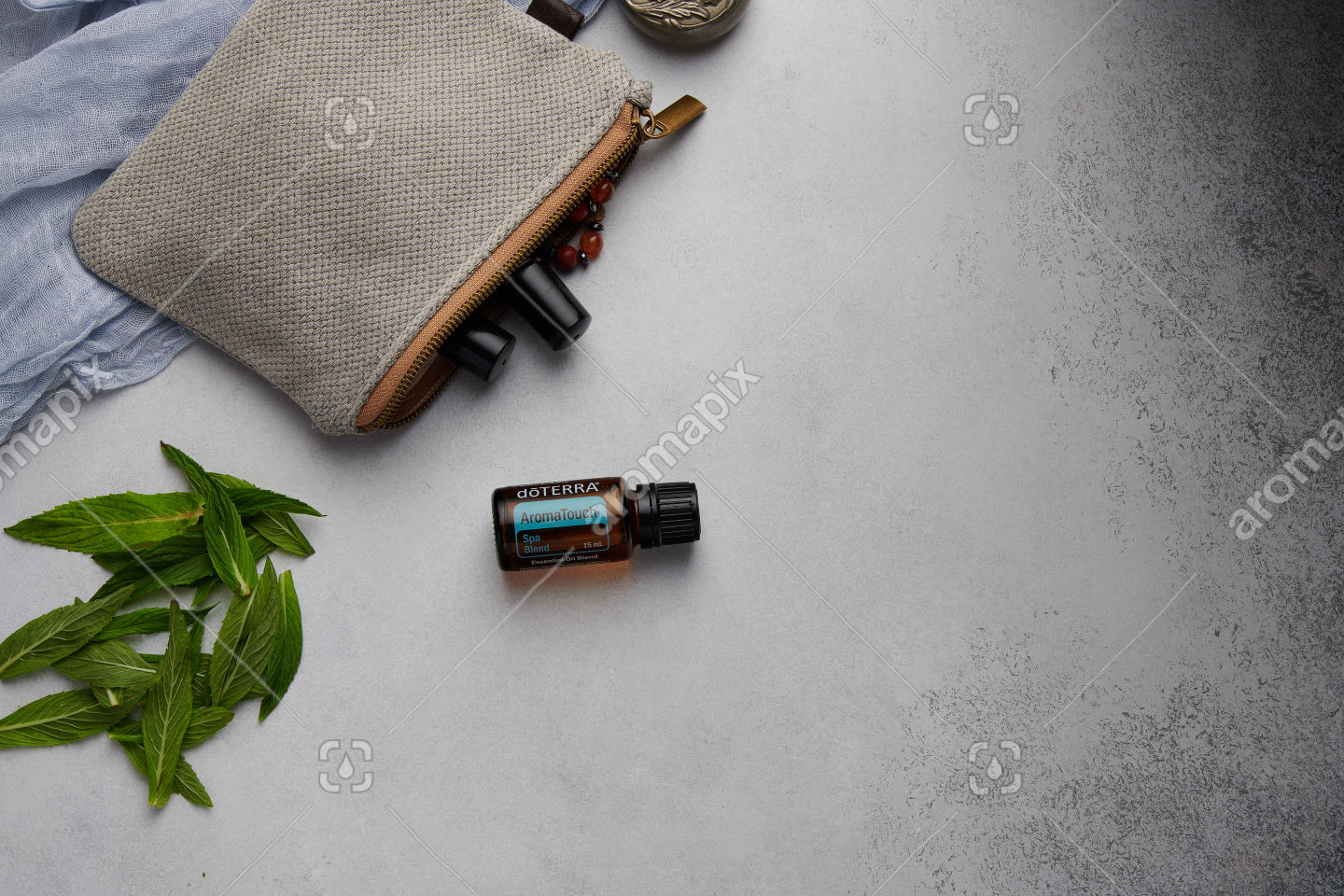 doTERRA AromaTouch with mint leaves on white
