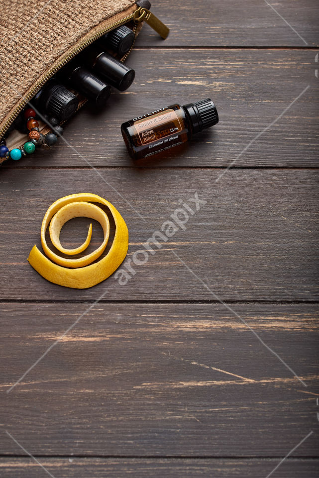 doTERRA Smart and Sassy with lemon peel on wooden background