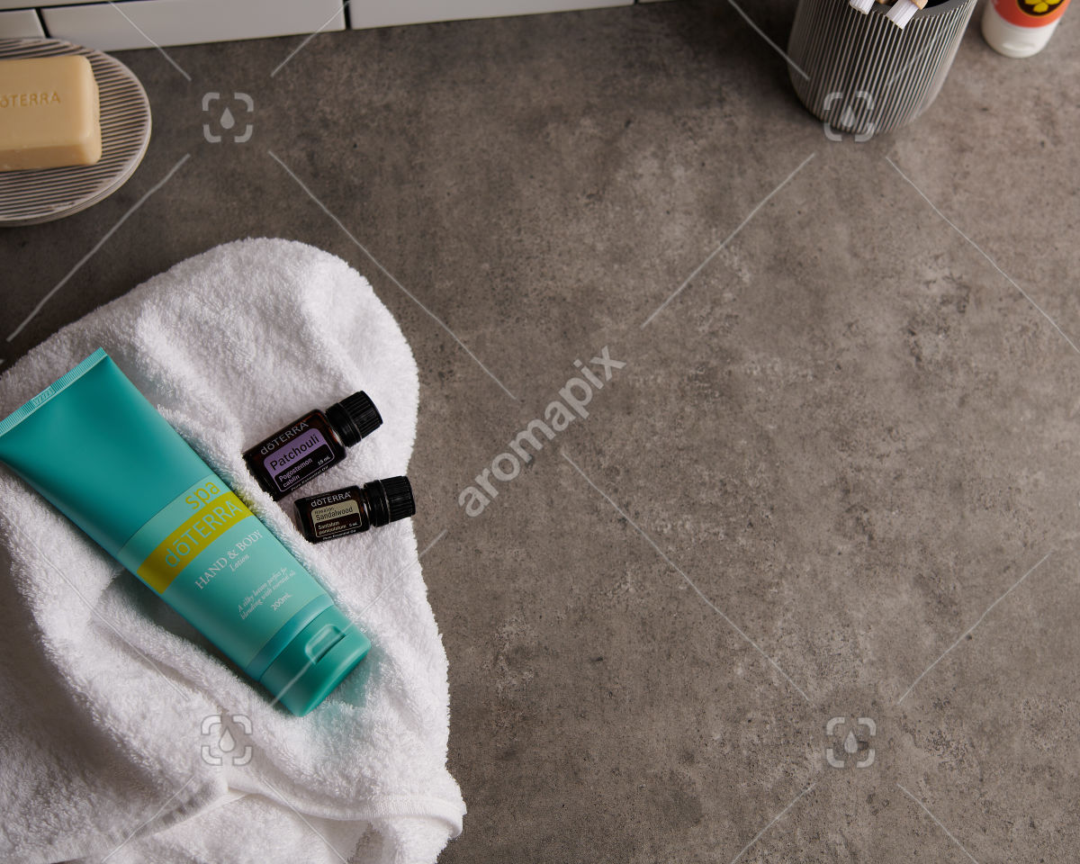doTERRA Spa Hand and Body Lotion with Patchouli and Hawaiian Sandalwood essential oils on white