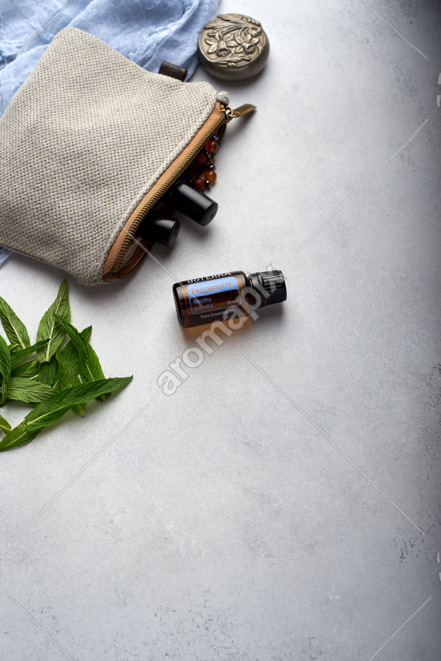 doTERRA Peppermint with mint leaves on white