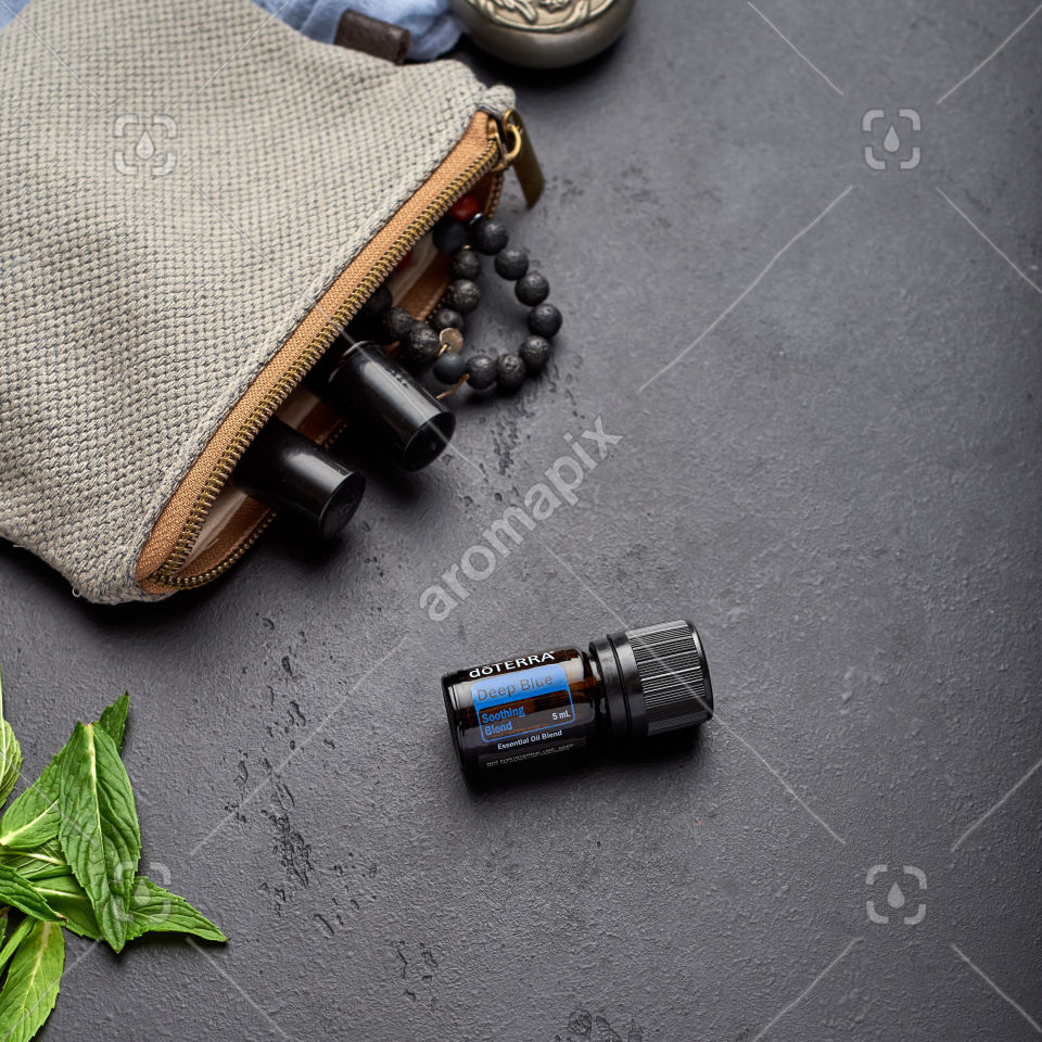 doTERRA Deep Blue with mint leaves on black
