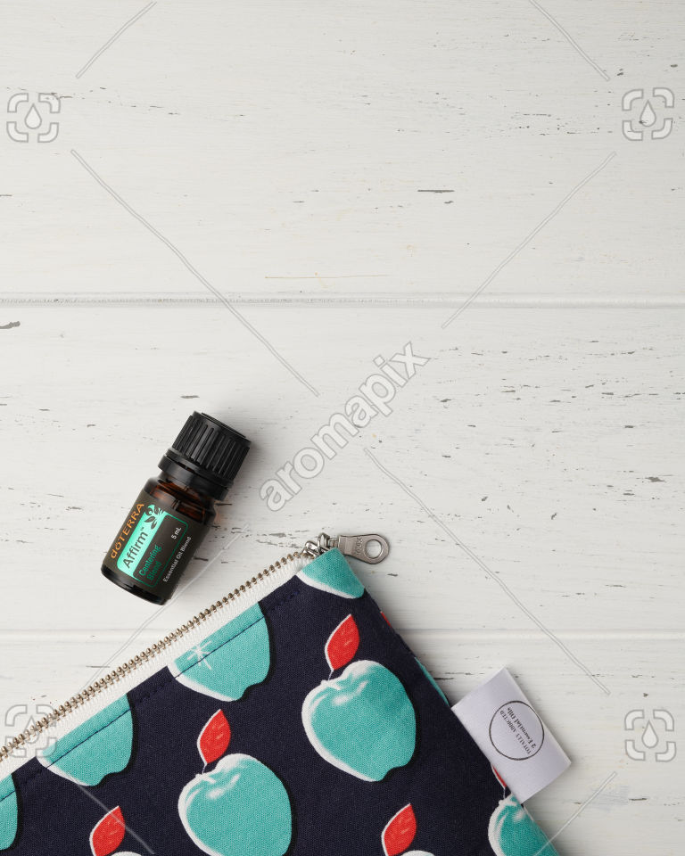 doTERRA Affirm with essential oil bag on white wood