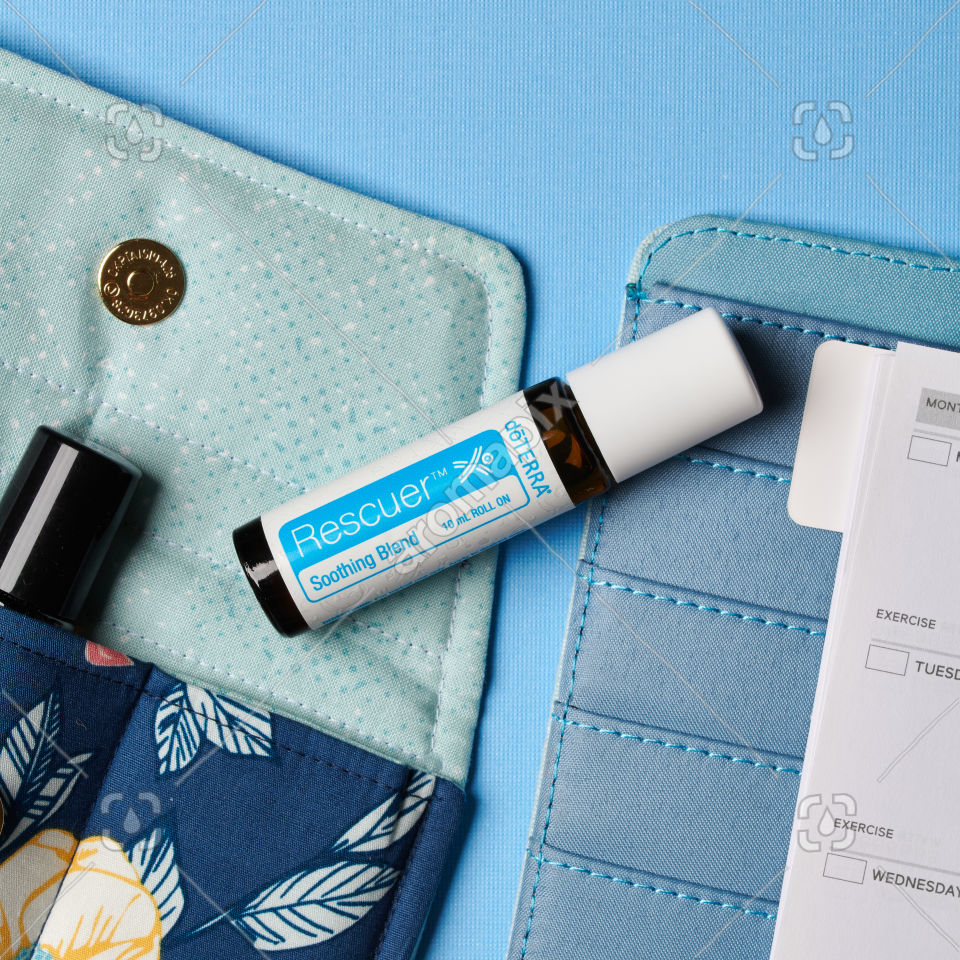 doTERRA Rescuer with accessories on blue