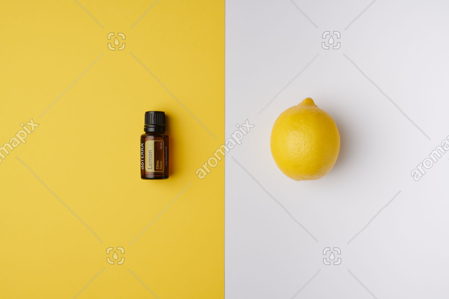 doTERRA Lemon product and fruit on yellow and white background