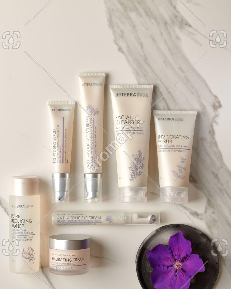 doTERRA Essential Skin Care Tightening Serum, Pore Reducing Toner, Invigorating Scrub, Anti-Ageing Moisturiser, Hydrating Cream, Facial Cleanser and Anti-Ageing Eye Cream on white