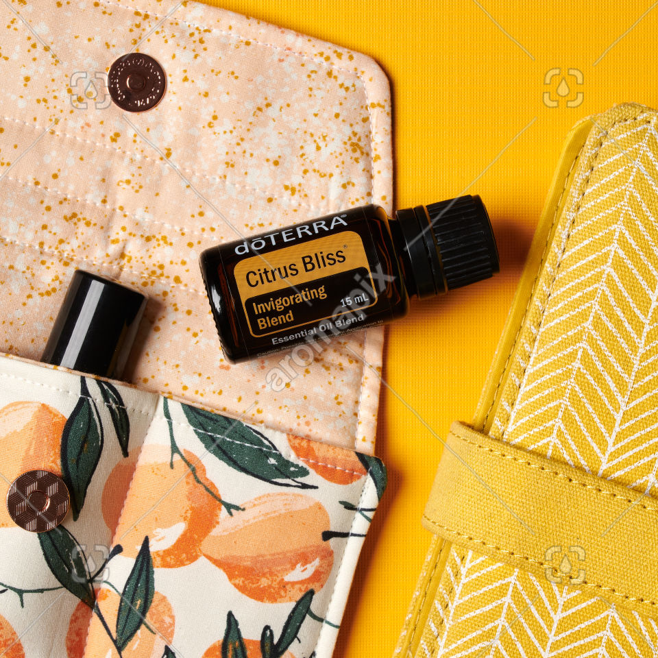 doTERRA Citrus Bliss with accessories on yellow