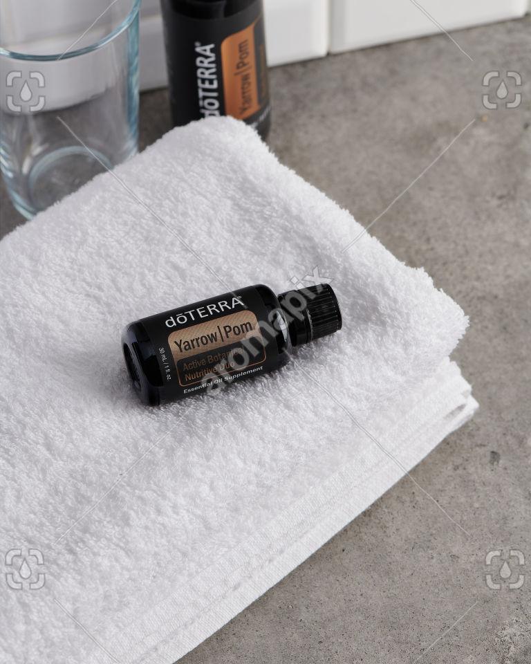 doTERRA Yarrow Pom and towel on bathroom bench