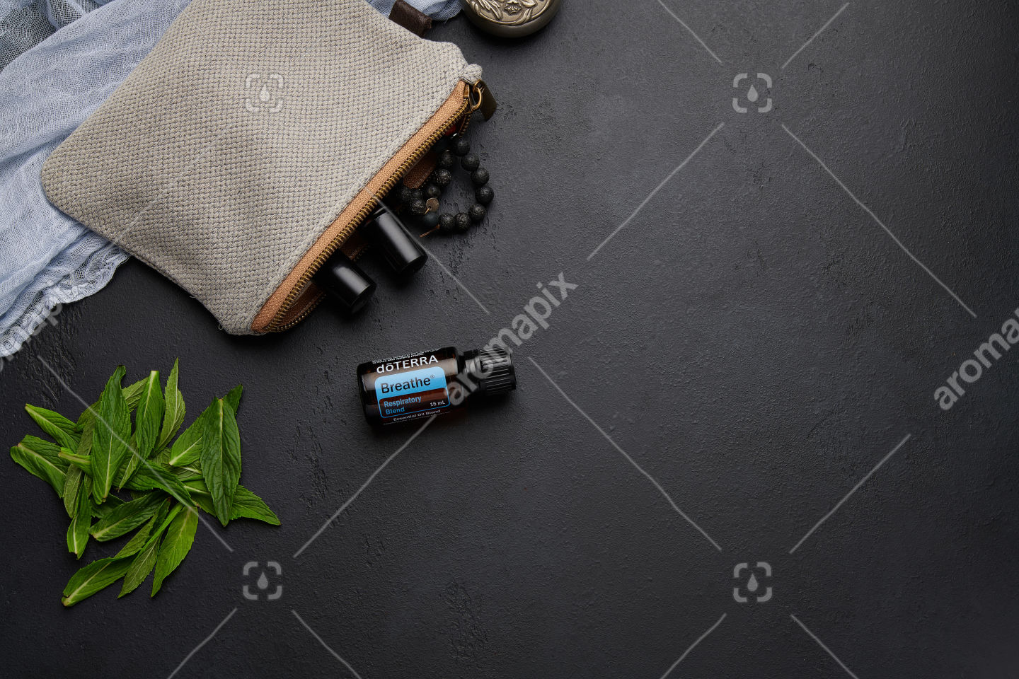 doTERRA Breathe with mint leaves on black