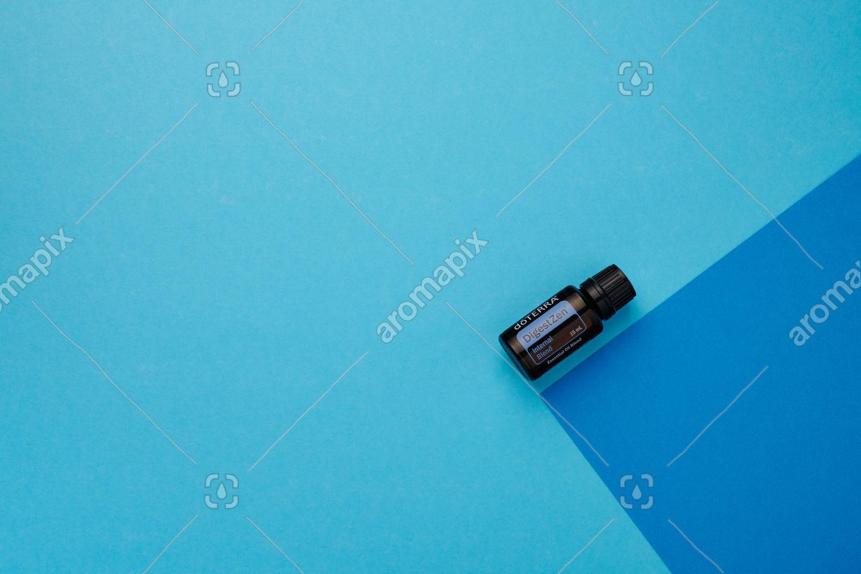 doTERRA DigestZen on a dark blue and light blue background