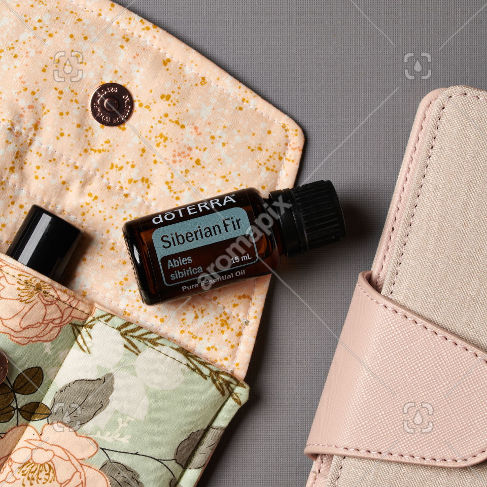 doTERRA Siberian Fir and accessories on gray