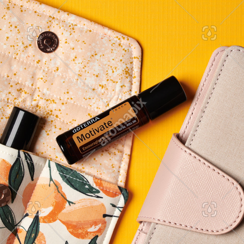 doTERRA Motivate Touch with accessories on yellow