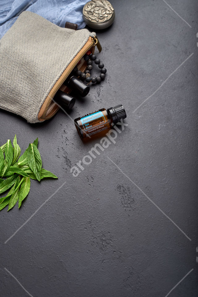 doTERRA AromaTouch with mint leaves on black